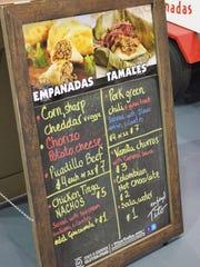 Empanada and tamale flavors change daily.