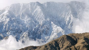 Mount San Jacinto contrasts with foothills below after heavy snowfall in snow in early January.