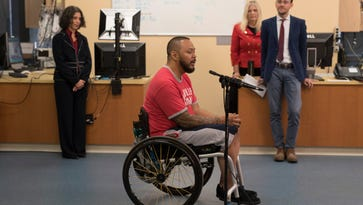 Louisville man can stand a decade after he was paralyzed in motorcycle crash