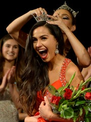 Amanda Rodriguez of Oxnard is crowned Miss Ventura County 2017 by Caitlyn Cappadona, Miss Ventura County 2016, as fellow contestant Olivia Sichmeller (left) applauds at California Lutheran University in Thousand Oaks.