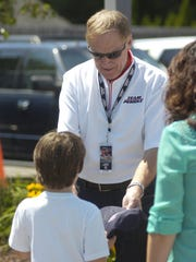 NASCAR legend Rusty Wallace hands Quinn Pascoe a signed autographed hat.