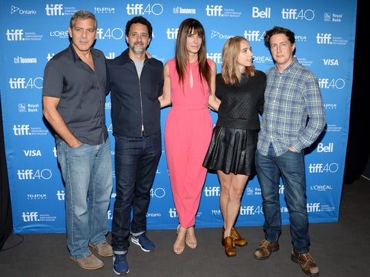 "George Clooney, and from left, Grant Heslov, Sandra Bullock, Zoe Kazan, and David Gordon Green attend a press conference for ""Our Brand is Crisis"" on day 3 of the Toronto International Film Festival at the TIFF Bell Lightbox on Saturday, Sept. 12, 2015, in Toronto. The film will be in theaters Oct. 30."