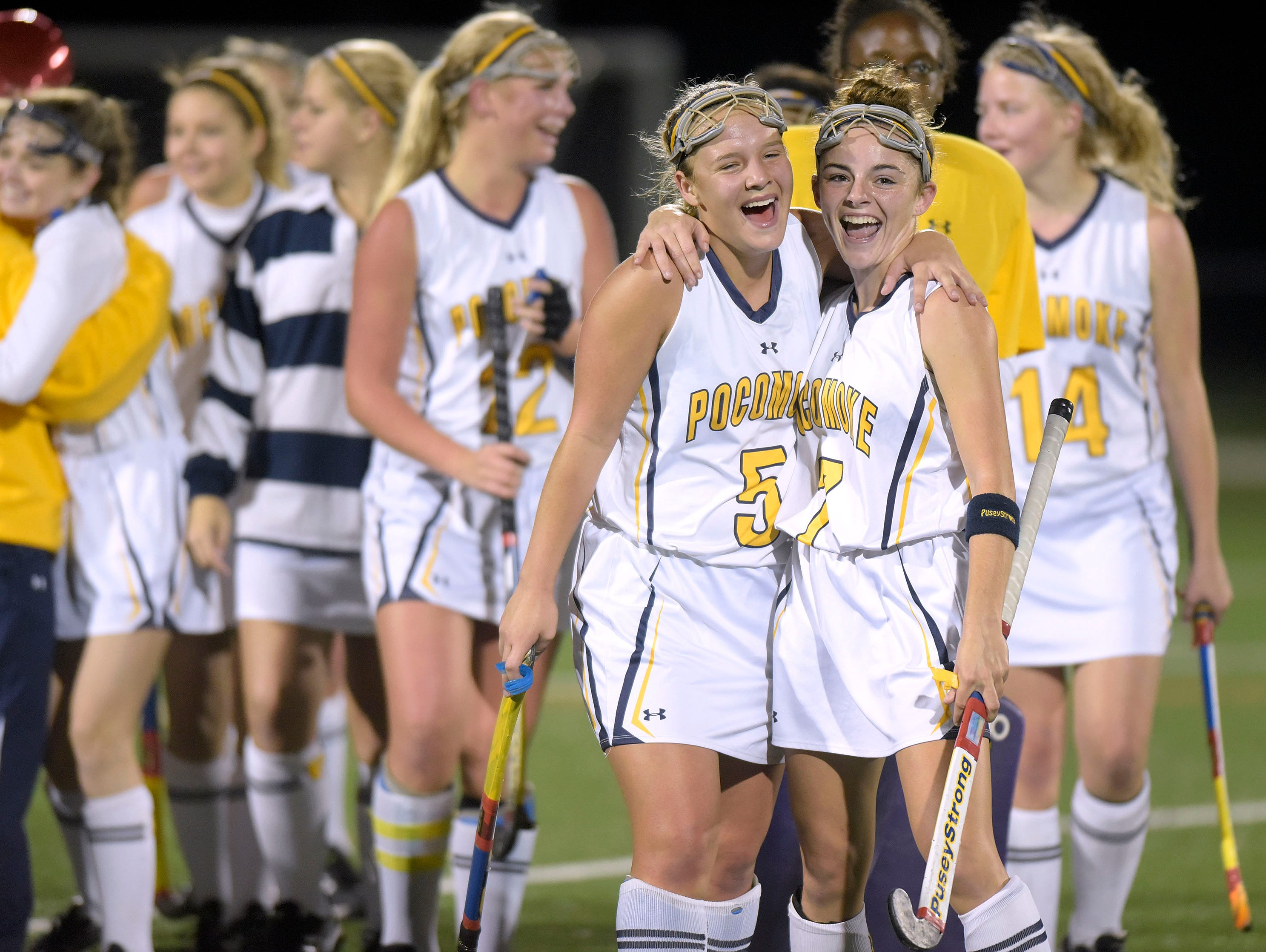 Pocomoke's McKenzie Mitchell, #5, and Peyton Becker, #7, celebrate after the team's 3-0 win against Manchester Valley in a Class 1A state semifinal field hockey game, Wednesday, Nov. 11, 2015 in Burtonsville.
