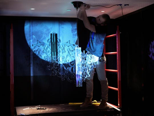 Chris McGregor of 21c Museum Hotel installs an art