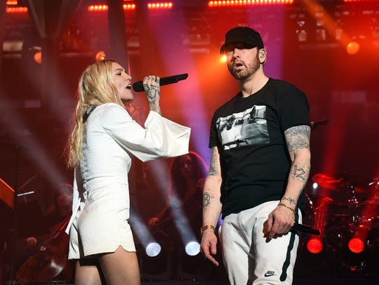 INDIO, CA - APRIL 15:  Skylar Grey (L) and Eminem perform