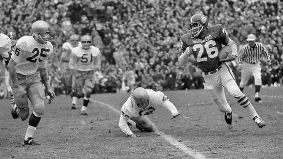 MSU running back Clinton Jones is pursued by Notre Dame defenders on Nov. 20, 1966.