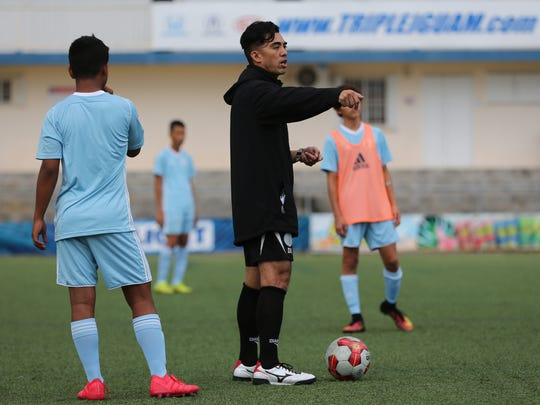Guam U15 Boys National Team head coach Dominic Gadia gives instructions to players during a recent training session at the Guam Football Association National Training Center. The team will be headed to Beijing, China PR next month for the EAFF U-15 Boys' Tournament 2018.