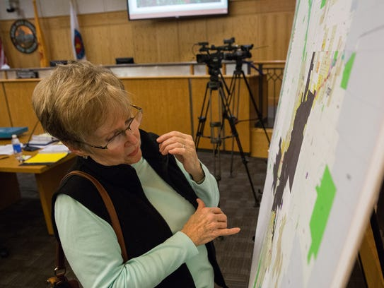 Penny Kaiser looks over the proposed Unified Development