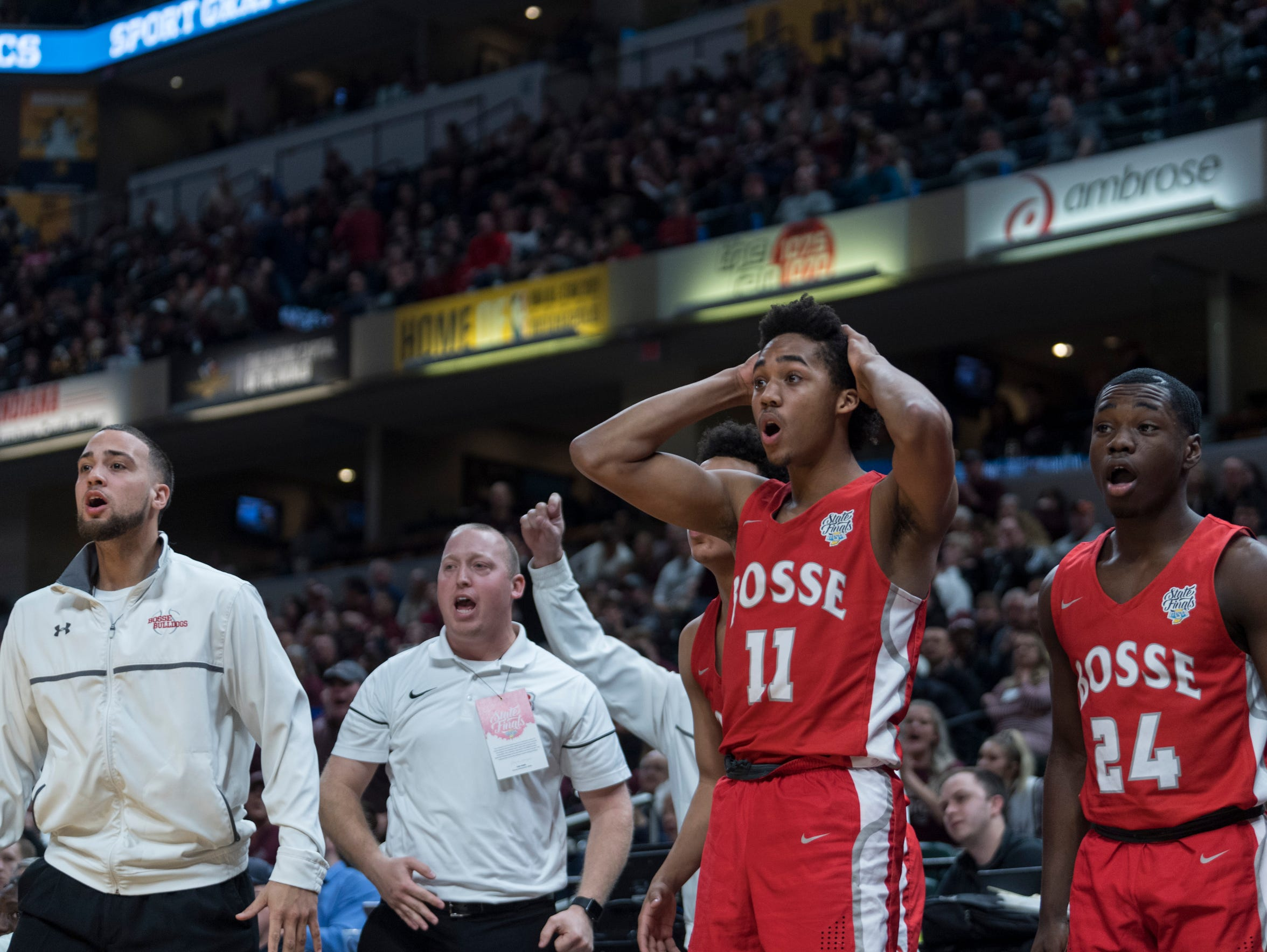 The Bosse Bulldogs bench reacts to foul call during