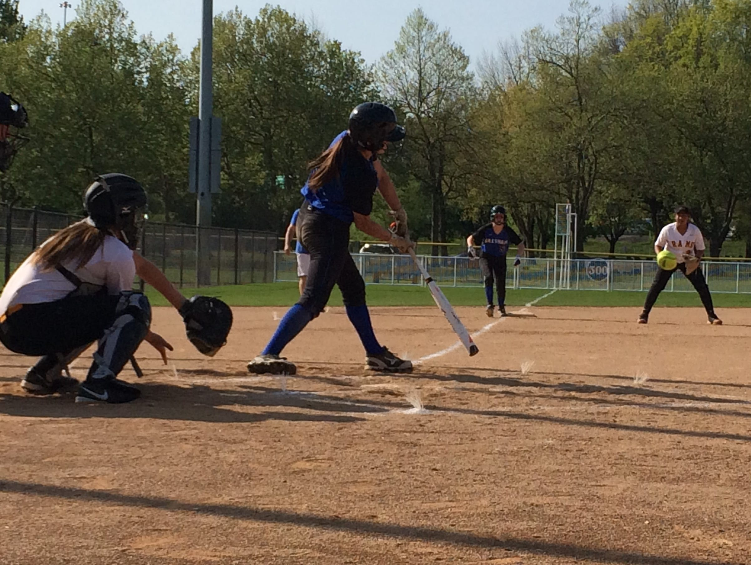Gresham's Emily Rose laces a two-run double down the right field line against Central Catholic.
