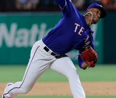 Dropped popup was key to Twins' 4-3 win over Rangers