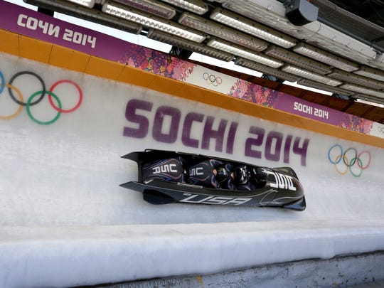 USA-1 team including Steven Holcomb in the final run of four-man bobsleigh during the Sochi 2014 Olympic Winter Games at Sanki Sliding Center.