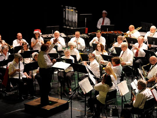 The Abilene Community Band performs its annual Christmas concert in 2016, at the Paramount Theatre. The concert has become a holiday staple, along with the band's performance during City Sidewalks.