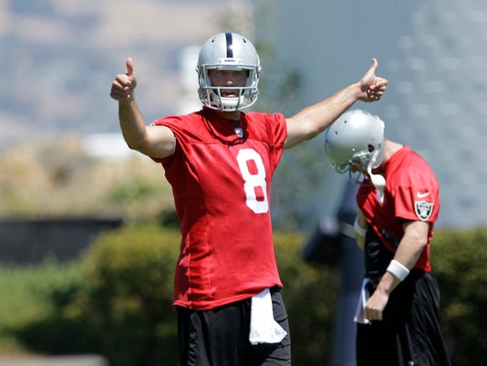 Oakland Raiders quarterback Matt Schaub directs a play at the Raiders mini-camp in Alameda, Calif., Wednesday, June 18, 2014.  Schaub was acquired by the Raiders from the Houston Texans for a sixth-round pick in the 2014 draft. (AP Photo/Rich Pedroncelli)