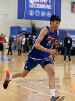 Zhou Qi, from China, participates in the NBA draft basketball combine Thursday, May 12, 2016, in Chicago.