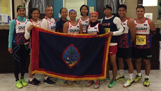 Civilians and Guam Army National Guard members who competed in the Army Ten-Miler in October included, from left: Mylene Garcia; officer candidate Christine Legaspi, 1224th Engineer Support Company; Sgt. 1st Class Peter San Agustin, Guam Army National Guard Element; Capt. Jocelyn Cabe, Guam Army National Guard Element; officer candidate Sheryl Padilla, 721st Signal Company; Lt. Col. Esther J.C. Aguigui, commander, Recruiting and Retention Battalion and Team Manager; Rhea Macaluso; officer candidate Napu Castro, 1st-294th Infantry Regiment's Headquarters, Headquarters Company; Sgt. Emmanuel Inciong, 1st-294th Infantry Regiment's Headquarters, Headquarters Company; and Sgt. Timothy Camacho, 1st-294th Infantry Regiment's Alpha Company.