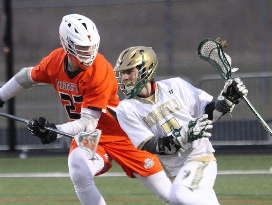 Howell's Eric McMillin (right) drives toward the net