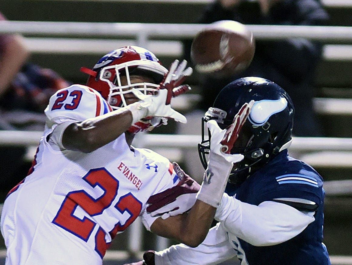 Evangel's Josh Walker pulls in the ball past Airline's D'kameron White for a touchdown.
