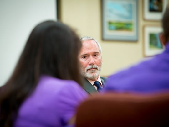 Door County District Attorney Raymond Pelrine listens as Alisha Bromfield's stepmother, Amy Heisner, reads a statement about the impact of Alisha's murder.
