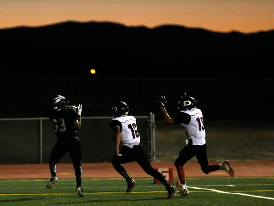 Shiprock's Donovan Chee catches a touchdown pass against