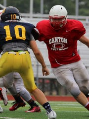 Offensive lineman Michael Maes blocks an opponent during