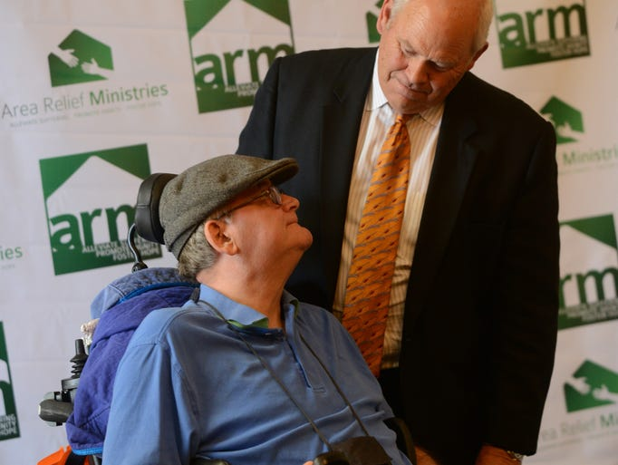 Former University of Tennessee football coach Phillip Fulmer met with fan David Rice Thursday at the Carl Perkins Civic Center before the Salt and Light banquet. Fulmer was the guest speaker for the Area Relief Ministries banquet , a nonprofit social service agency that serves low-income families and homeless individuals.