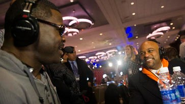 In this January 31, 2014 file photo, Michael Irvin, a former Dallas Cowboys wide receiver and current NFL Network analyst, and Denver mayor Michael Hancock speak on The Press Box at the Sheraton Hotel Times Square on Radio Row in New York, New York. Hancock is seeking guidance from the city Board of Ethics on plans to pay for his family's trip to watch the Broncos play in the Super Bowl.