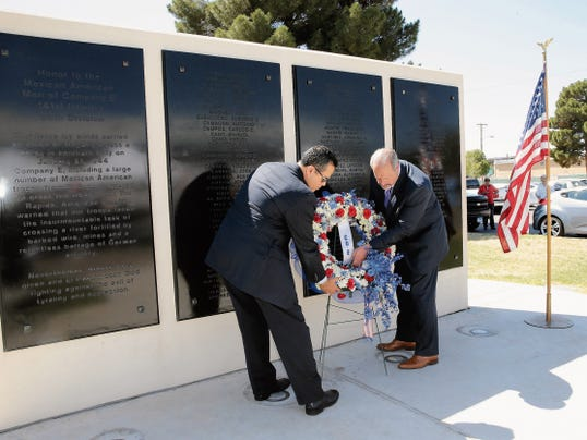 RUBEN R RAMIREZ—EL PASO TIMES City Manager Tommy Gonzalez and Mayor Oscar Lesser place a wreath at the foot of the Rifle Company E of El Paso Memorial during a ceremony held in honor of those that served and those that gave their lives along the surviving members of the rifle company.