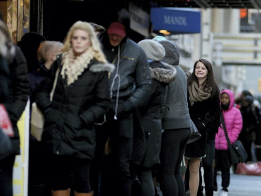 Julia Adams, anxiously waits in line as people wait in line along 54th Street in New York City on a chilly morning to sign up for open casting calls for the Gretna Theatre's summer season on Tuesday, March 24, 2015.