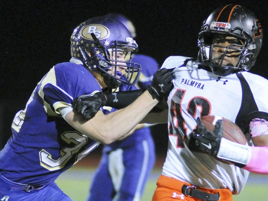 Palmyra's Alon Rhette against Boiling Springs' Jack Foreman during the game at Boiling Springs on Friday, October 9, 2015.