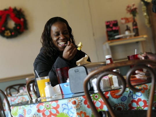 Cynthia Johnson jokes while having lunch at the Roosevelt Diner.