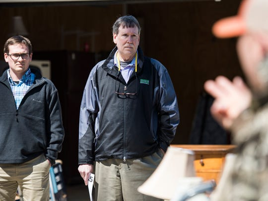 Barry Dietrich and his son Jeff participate in a real estate auction at 98 Salado Lane in Mauldin on Thursday, March 21, 2018.