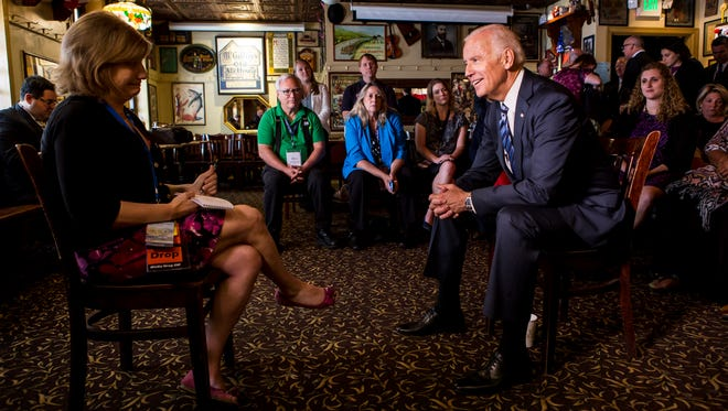 Vice President Joe Biden discusses his career in an interview with News Journal reporter Margie Fishman (left) after meeting with Delaware's delegation to the Democratic National Convention, sitting behind him, at McGillin's Olde Ale House in Philadelphia, Pa. on Wednesday morning.
