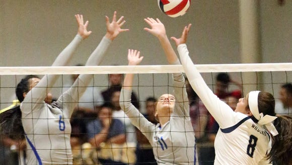 Victoria Flores, 8, of Fabens tries knocking the ball