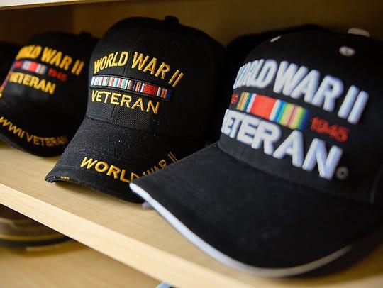 World War II veteran Gerald Olson, 89, adds to his