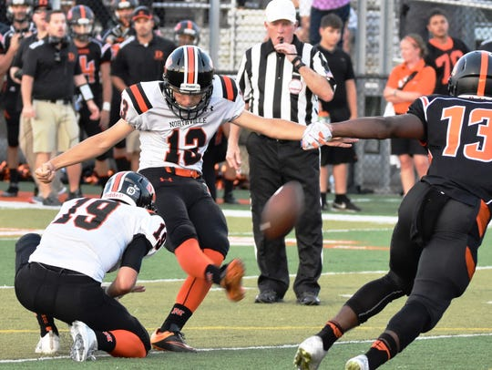 Northville kicker Jake Moody (middle) booted a school-record