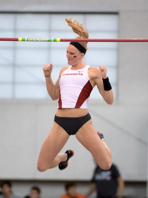 Greenville's Sandi Morris celebrates as she clears safely to win the women's pole vault at 15 feet, 1 inch for the University of Arkansas women's track & field team in the 2015 NCAA Indoor Championships.