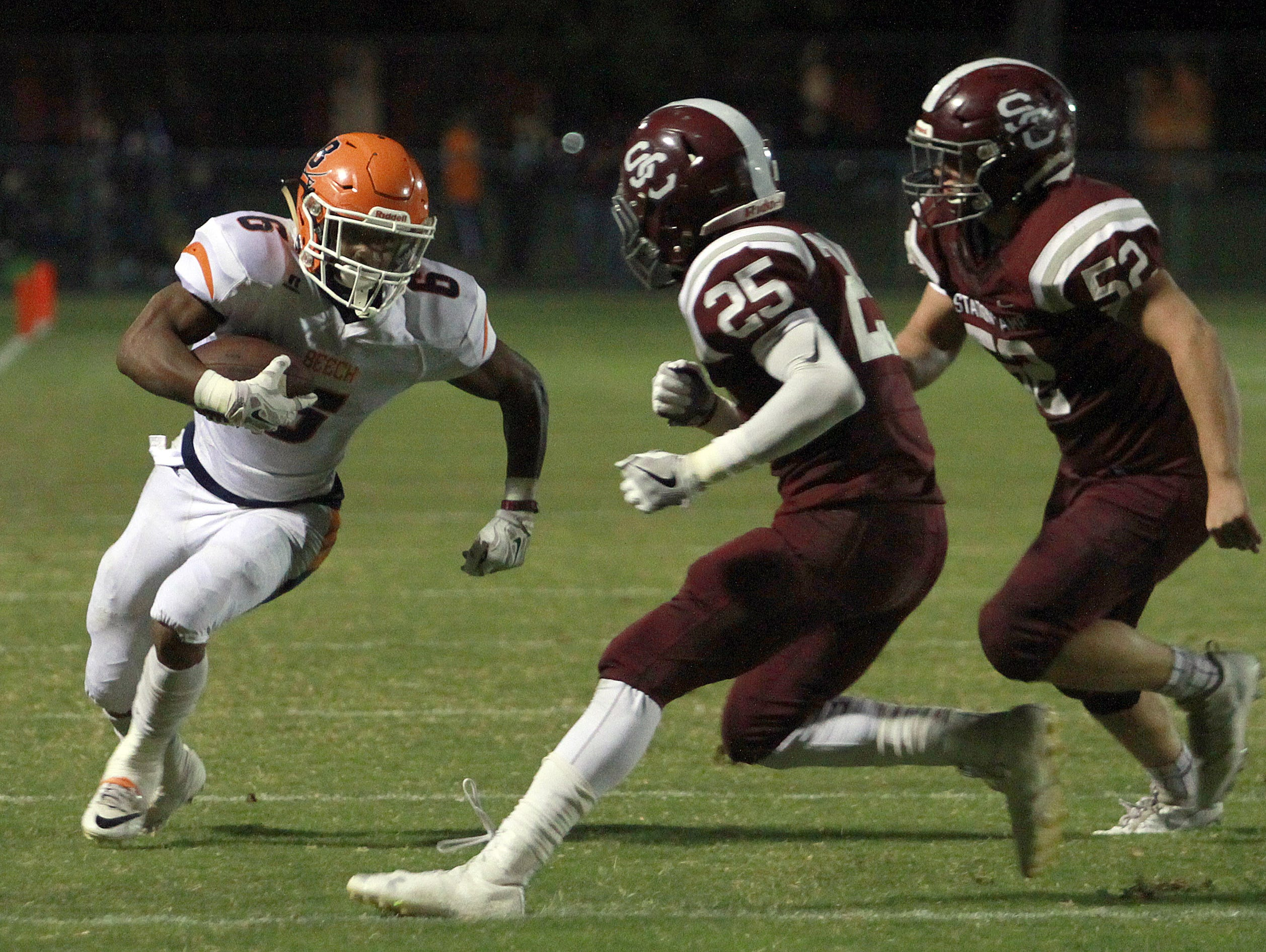 Beech's Alex Vanzant rushes as Station Camp's Shawn McKinley (25) and Simon Freeman force him to the sideline and short of the goal line during their game earlier this season. Beech is ranked ninth in this week's Class 5A poll and hosts Hunters Lane on Friday.