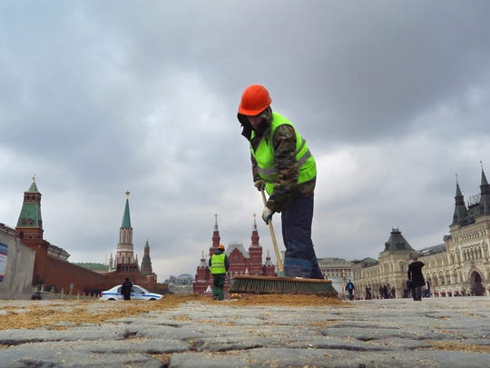 Workers prepare Red Square before the Victory Day parade