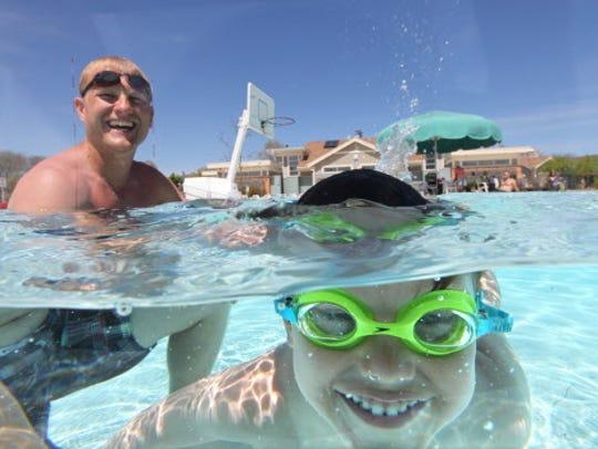 Jonah Van Dunk, 3 takes a dip as his father Reid Van