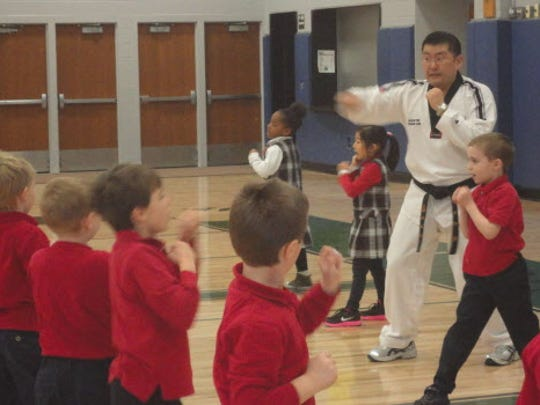 Master Chan Lee, the Bully Expert from JK Lee Black Belt Academy, is teaching St. John Vianney students age-appropriate verbal anti-bullying skills. Students learn that self confidence, assertive body posture and facial expressions are important bullying deterrents.