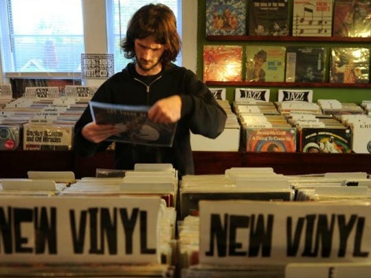 Matthew Stager of Madison looks through vinyl records at The Groove.