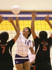 Kirtland Central's Nia Nelson records a kill against Gallup on Tuesday at Kirtland Central.
