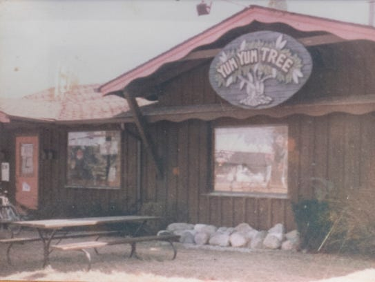 A framed photo of the original location of the Yum