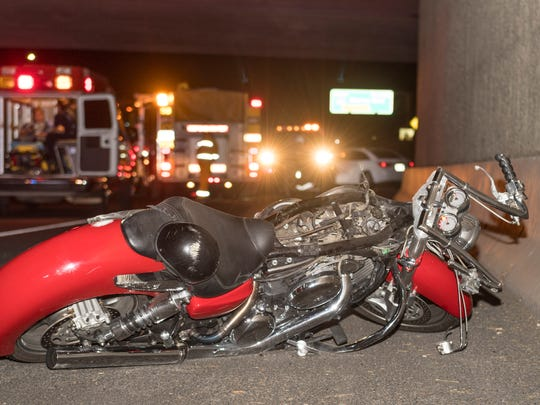 CHP and Visalia Police and Fire Departments respond to multiple collisions involving a motorcycle and several vehicles in the eastbound lanes of Highway 198 on Thursday, July 12, 2018. Wreckage including a burning car was strewn for about a quarter-mile after the motorcycle struck the back of a car. The motorcycle's gas tank broke away and was struck and dragged by a third car before it erupted in flames just east of Demaree. Other vehicles collided shortly afterward in the confusion. Only minor injuries were reported. The roadway was closed in the aerator about an hour while crews cleaned up the debris.