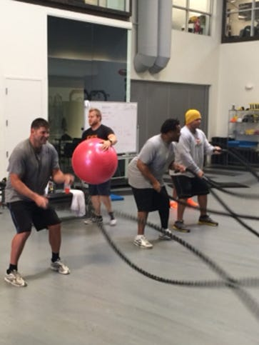 In June, former NFL players participate in exercise