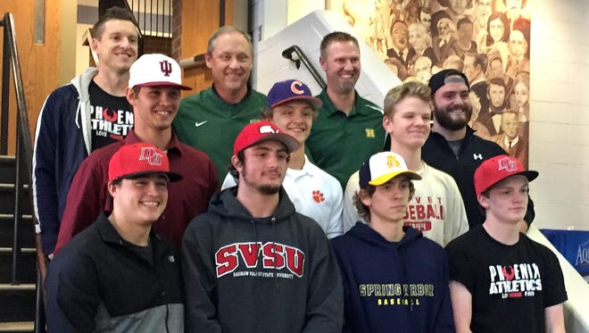 Howell baseball players who have signed with college programs are (front row, left to right) Kaedan Palmer, Logan Russo, Brandon Leon, Evan Maize (middle row) Caleb Balgaard, Sam Weatherly and Seamus Mitchell. Pictured in the back row are trainer Chris Down, coaches Mike Weatherly and Jason Ladd, and trainer Shane Hall.