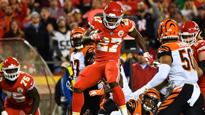 KANSAS CITY, MO - OCTOBER 21: Kareem Hunt #27 of the Kansas City Chiefs leaps over a would be tackler during the first quarter of the game against the Cincinnati Bengals at Arrowhead Stadium on October 21, 2018 in Kansas City, Kansas. (Photo by Peter Aiken/Getty Images) ORG XMIT: 775192665 ORIG FILE ID: 1052724186