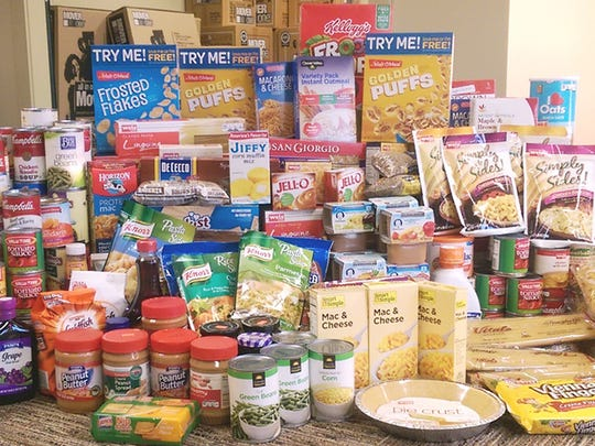 Investment Real Estate Management, LLC collected 927 food items during their annual food drive.