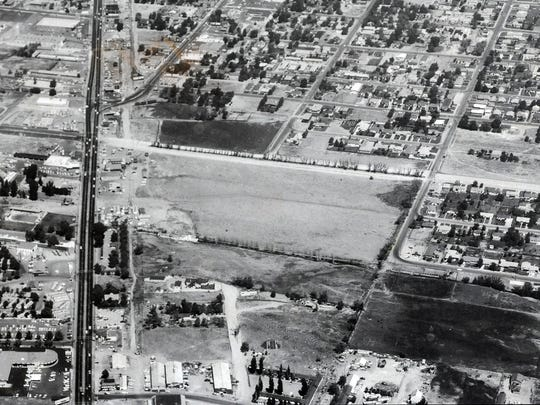 The area around Plumb and Virginia in Reno is shown in this aerial photo looking northward taken sometime before 1963. The large cleared area in the center is where Park Lane Mall would eventually be constructed, with Shoppers Square going into the smaller area clearing north of it.  Ralph Casazza walks through Shoppers Square, the Reno shopping center he founded in 1963. Photo taken on Wednesday, Jan. 27, 2010. Photo by David B. Parker. CaptainCasazza07